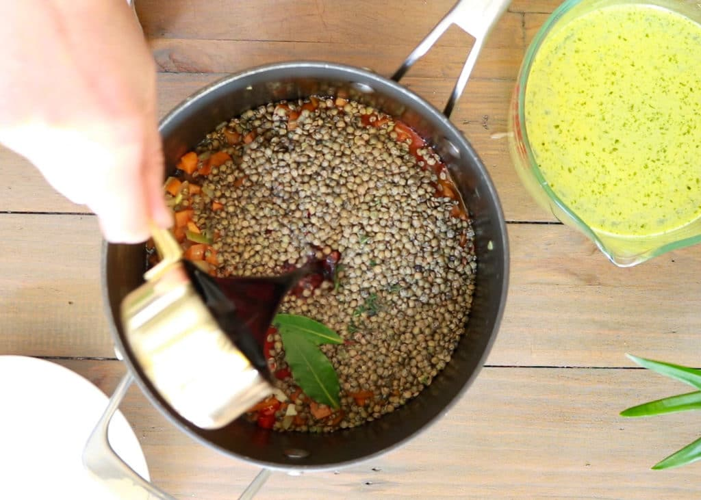 Image showing adding ingredients to the pot