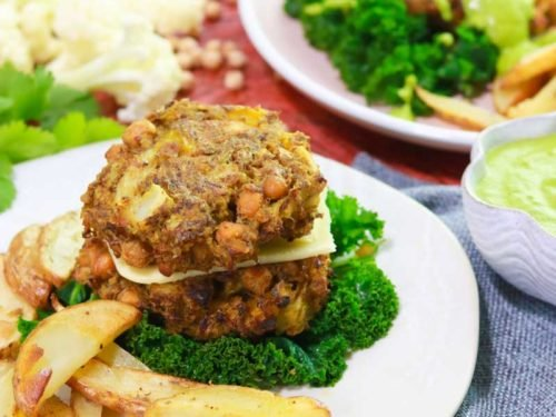 Cauliflower & Chickpea burgers on a plate with big chips