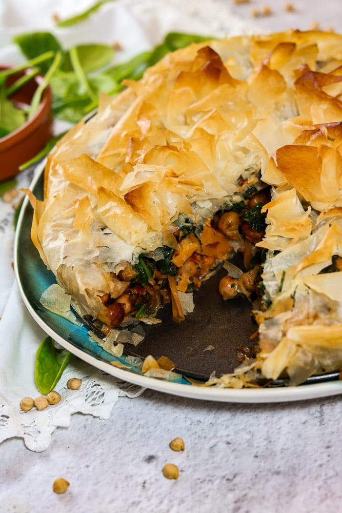 Butternut Squash, Chickpea and Spinach Filo Pie with a piece cut out.