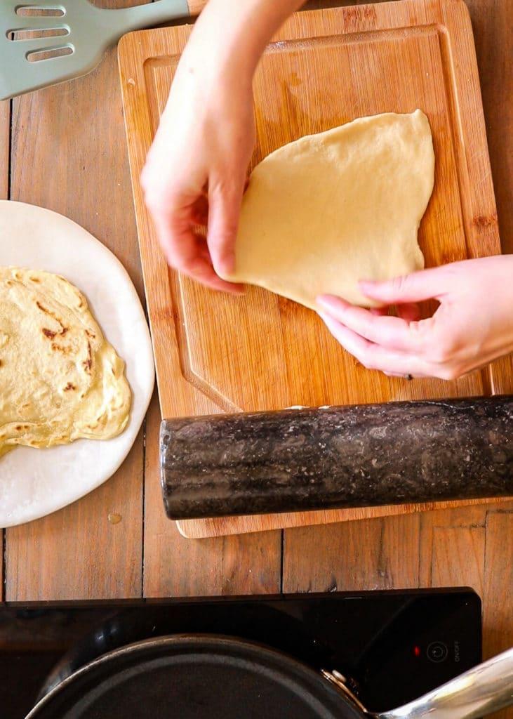 showing how to flatten dough.