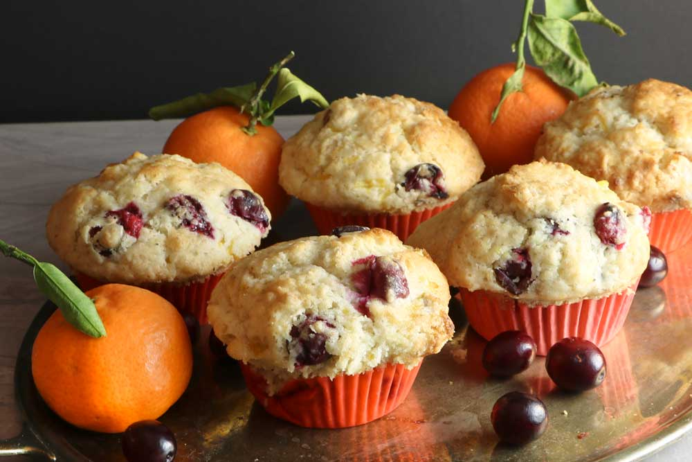 Vegan Clementine and Cranberry fruity muffins on a tray