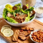 Vegan Caesar Salad with chickpea Croutons in a bowl.