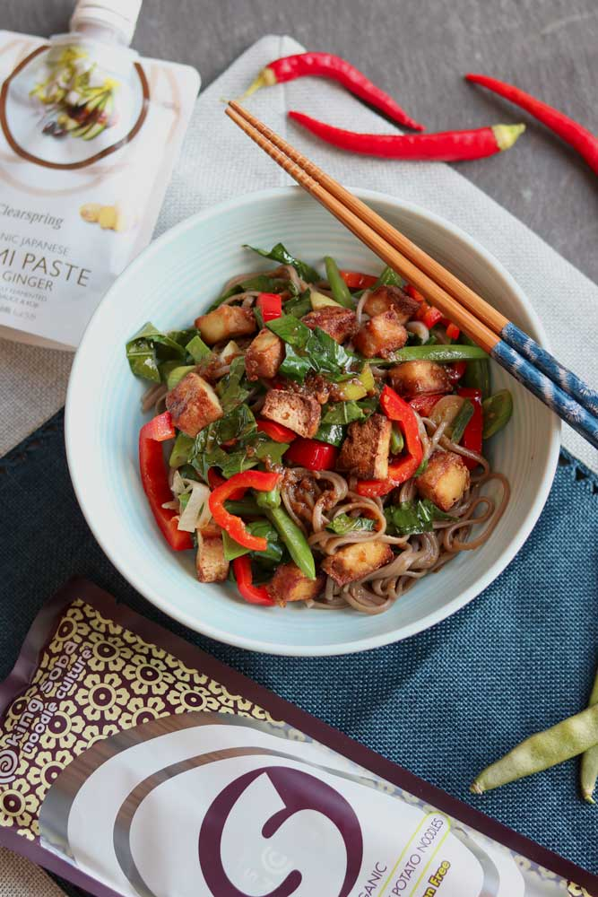 Crunchy Tofu Stirfry with Soba Noodles on a plate with chopsticks