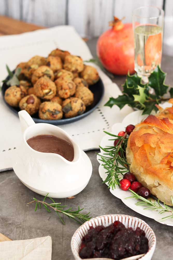 Vegan tameph balls with gravy and wreath in foreground