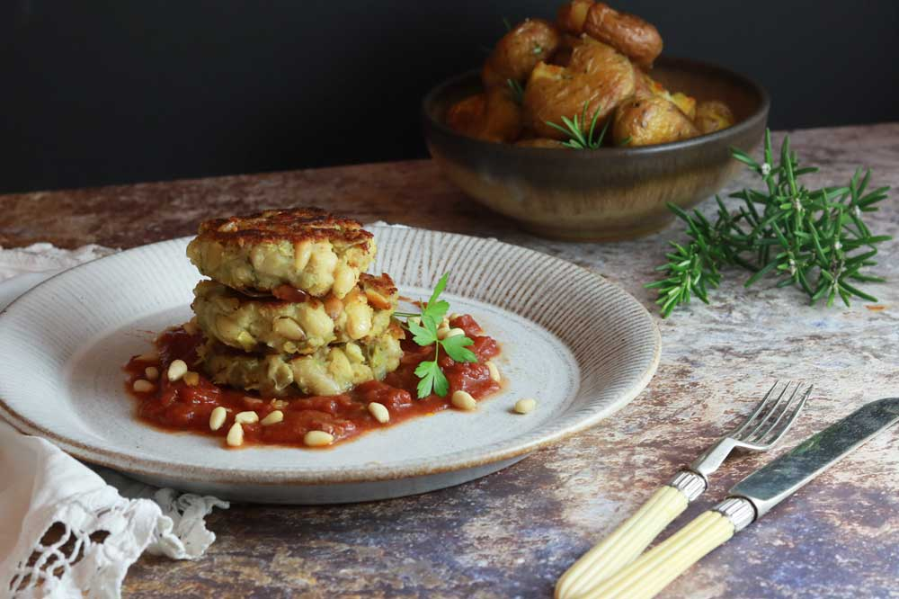 Vegan crabless cakes with potatoes in the background