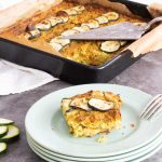 Courgette and Leek frittata with a slice on a plate
