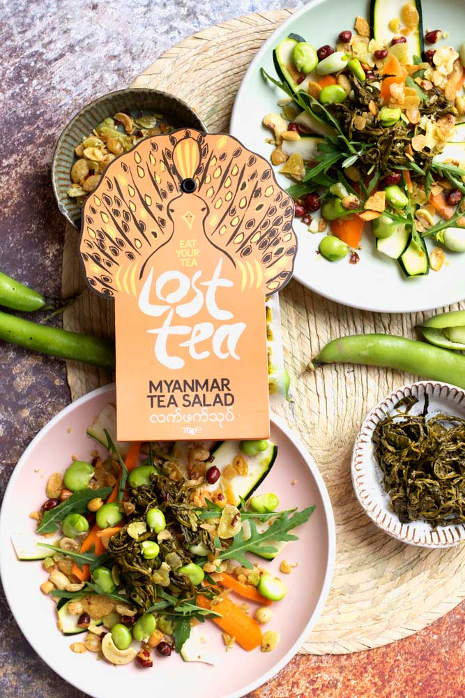 Fermented Tea Salad by Lost Tea with salad behind them