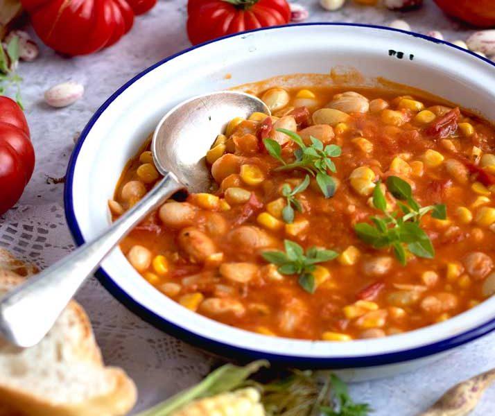 Borlotti, corn & tomato stew in a plate