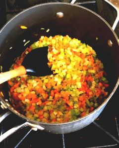 Celery, Carrot, Onion in a pot, with the peas just popped in over the top