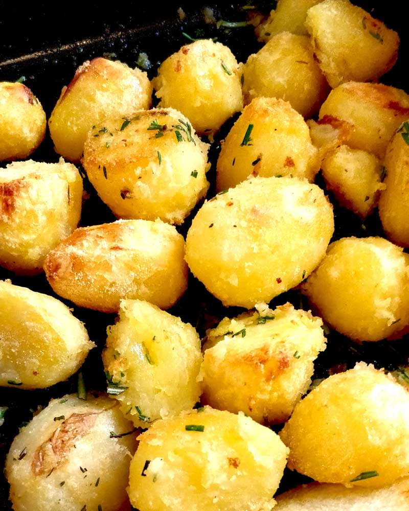 Roasty Potatoes in a pan.