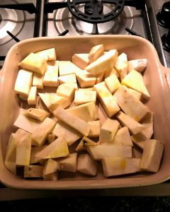 Celeriac in a roasting dish about to go into the oven
