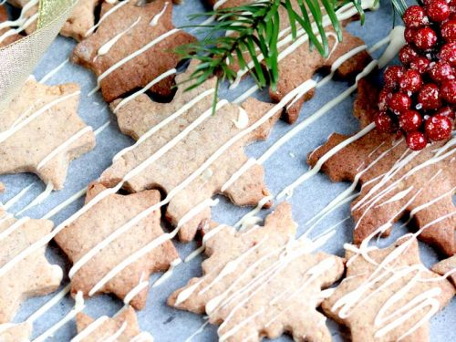 Vegan Cinnamon and Macadamia Biscuits with White Chocolate Drizzle on a tray ready to serve