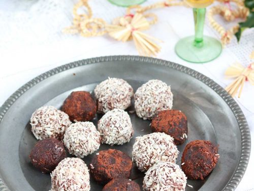 Vegan Rum Balls on a plate with little glasses of rum beside them
