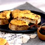 Vegan Welsh Rarebit on a plate with a pot of chutney