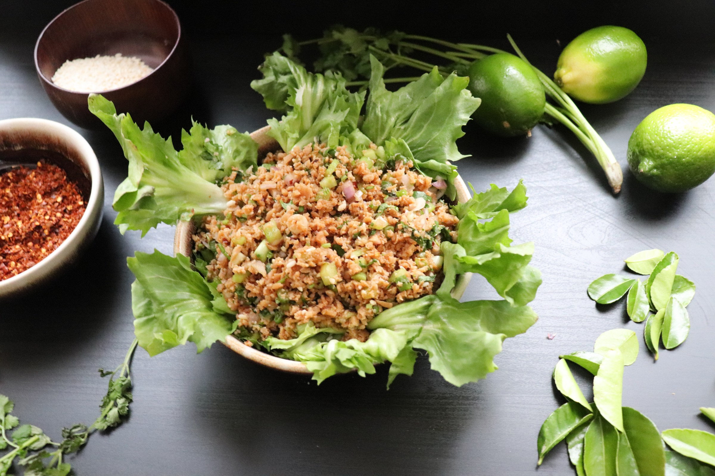 Vegan meat salad in a big lettuce leaf in a bowl