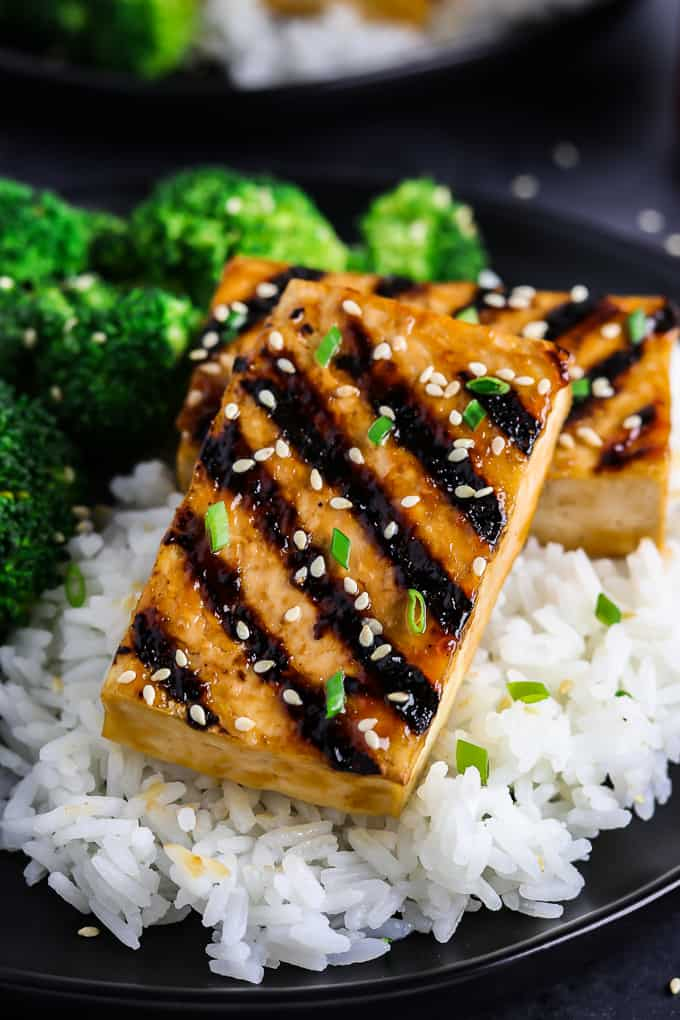 Grilled tofu on a bed of rice and broccoli