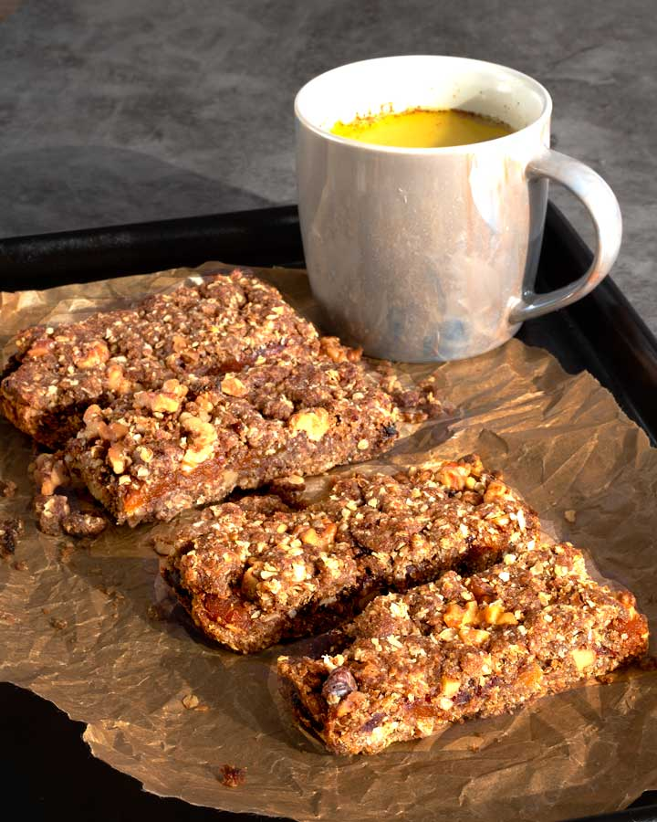 Vegan apricot and walnut bars with a cup of turmeric latte