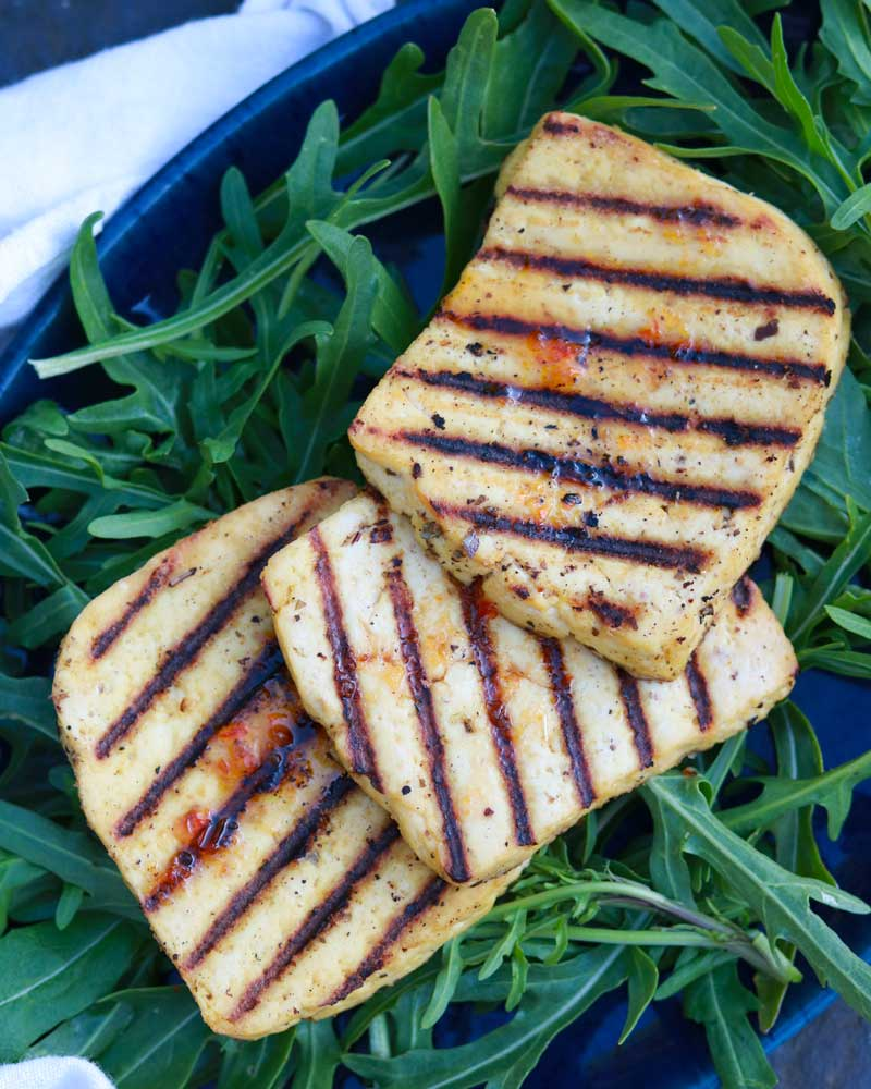 Tofu Halloumi on a plate with salad