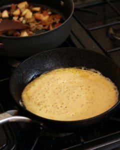 Vegan Omelette in the pan before flipping