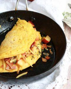 Vegan Omlette in the pan, folded over the filling