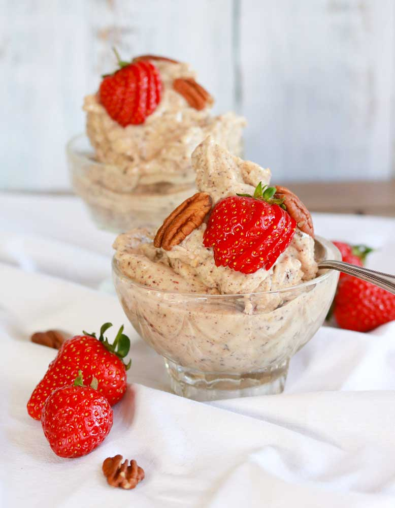 Vegan 4 Ingredient Icecream in two bowls with strawberries & nuts