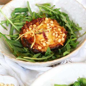 Harissa Mushroom on a plate with rocket leaves