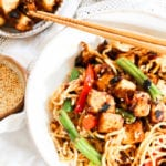 Noodles in a bowl topped with crispy tofu
