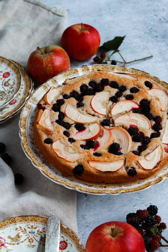 Apple and blackberry cake on a plate.
