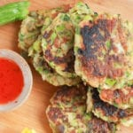 Courgette Fritters stacked up next to sweet chili dipping sauce