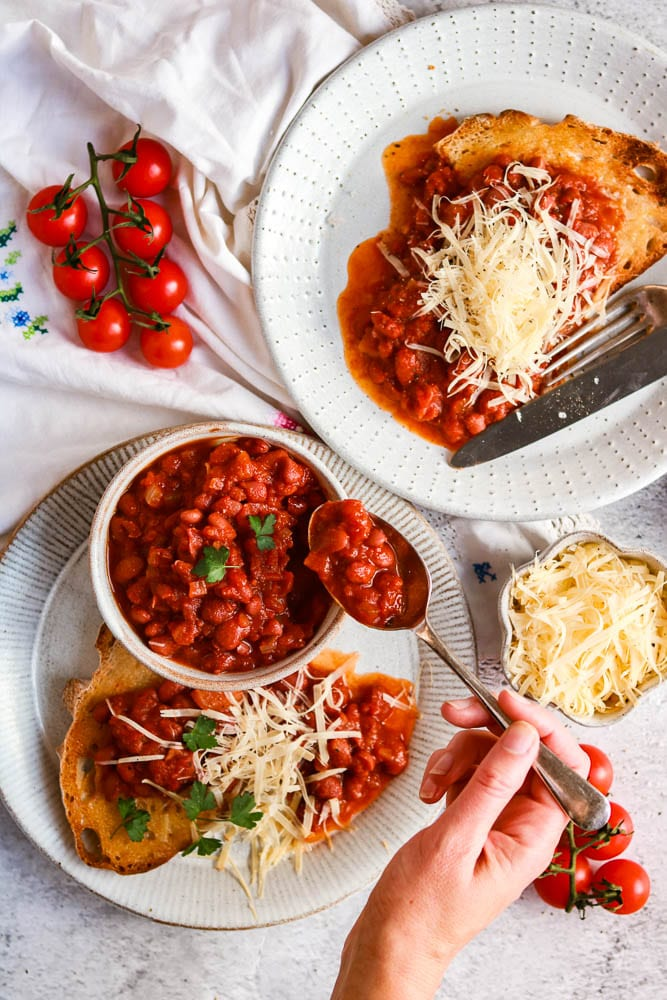 Baked Beans being served on a plate.