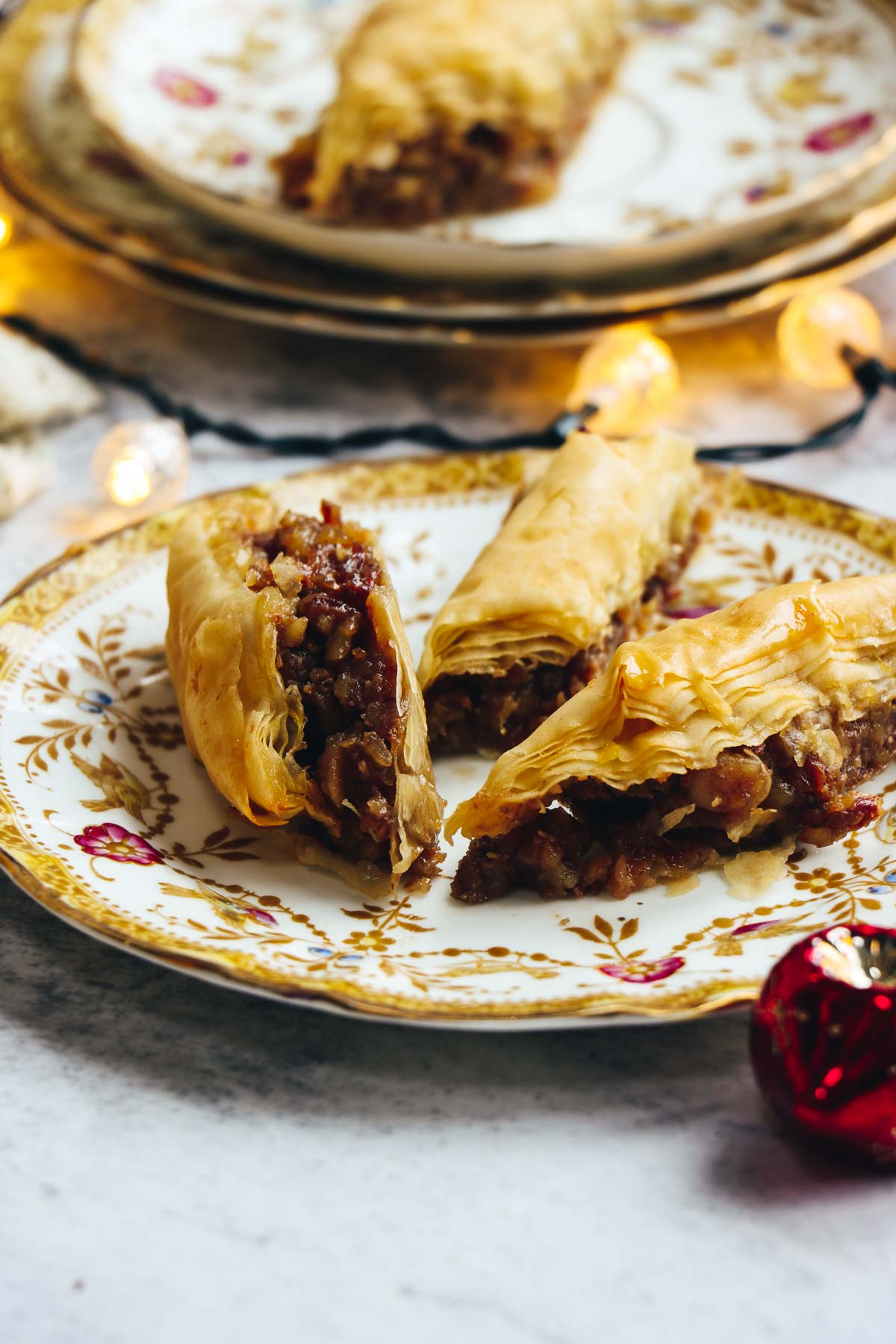 Three pieces of mince pie baklava on a plate.