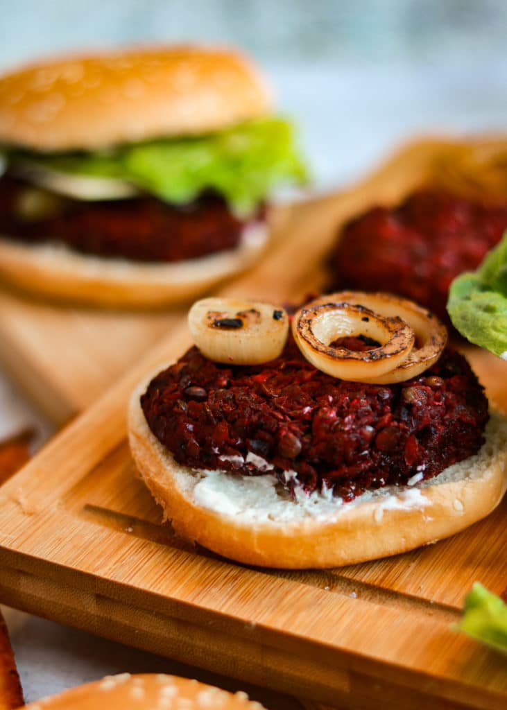 Beetroot Burger on a bun with some grilled onion on top