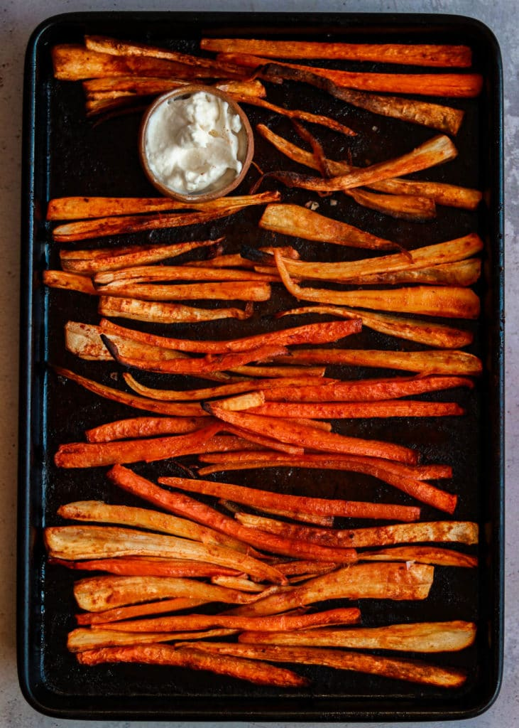 Parsnip and carrot fries just out of the oven ready to serve.