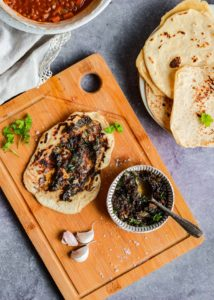 Garlic Butter and Flatbreads on a board