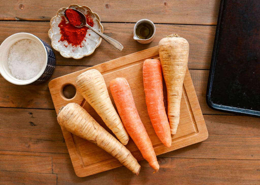 Carrots, parsnips, oil and seasonings ready to be made into fries.