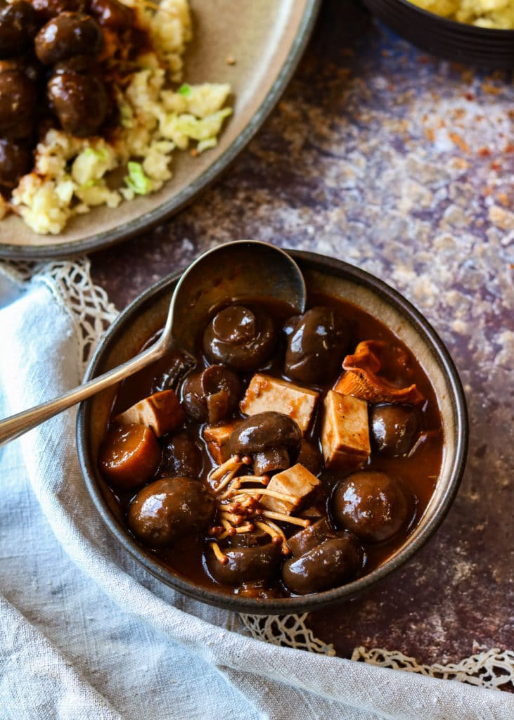 Mushroom Bourguignon in a bowl with a spoon.