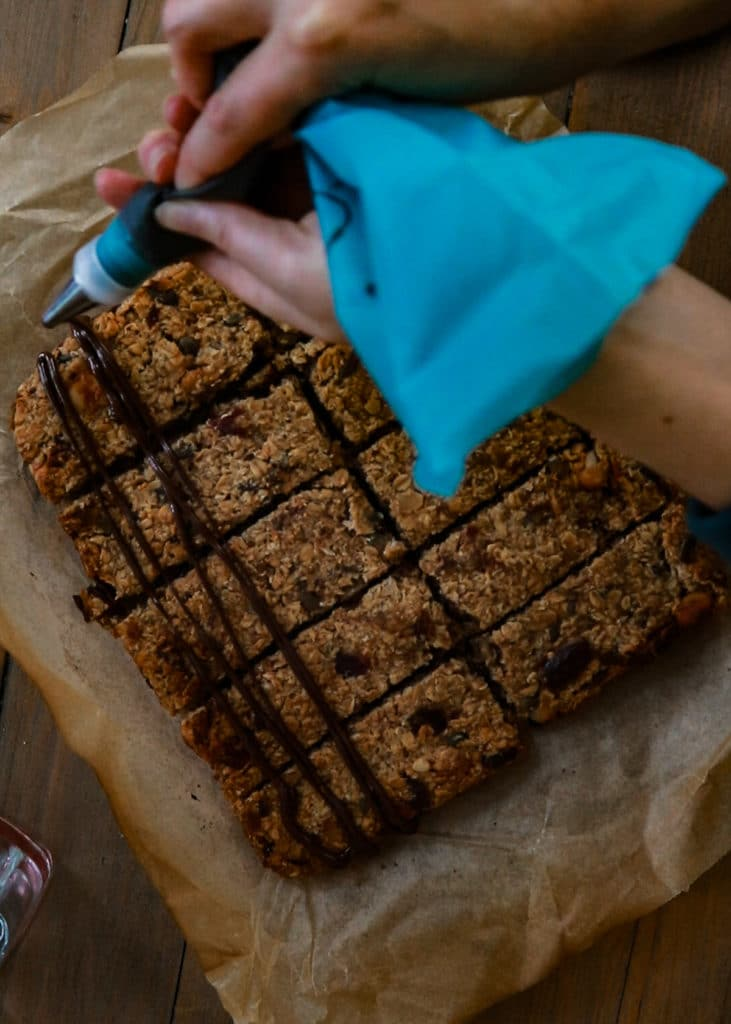 How To Image : Drizzle, squizzle, drip or dip the flapjacks with chocolate.