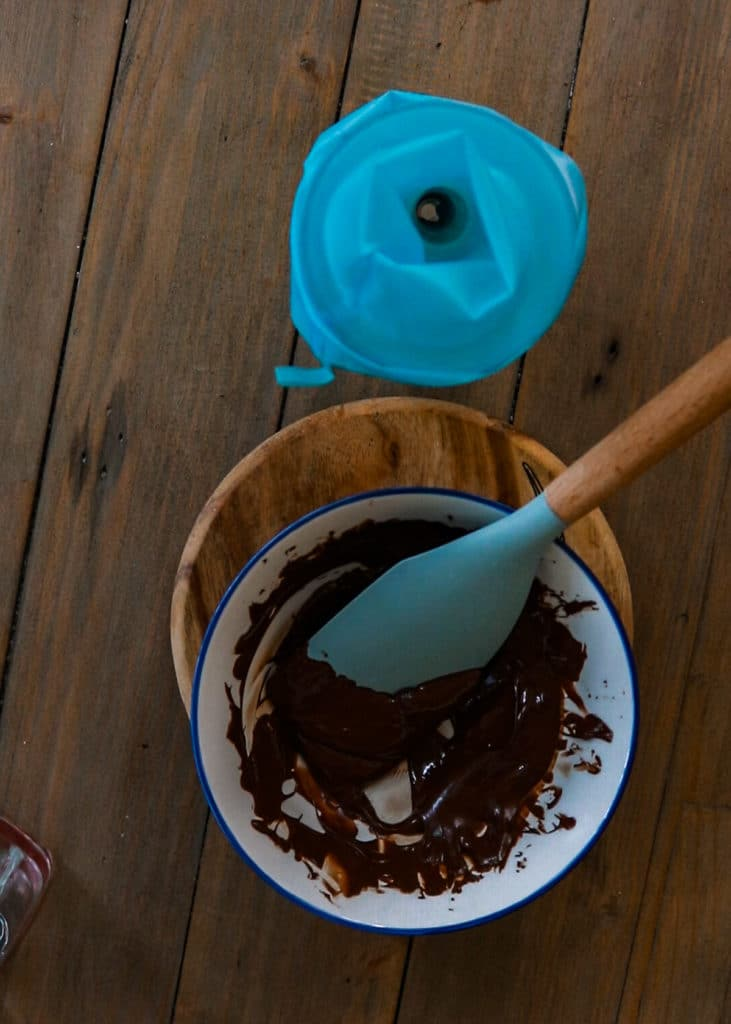 How To Image : Melt chocolate. Add to a piping bag if you are fancy,