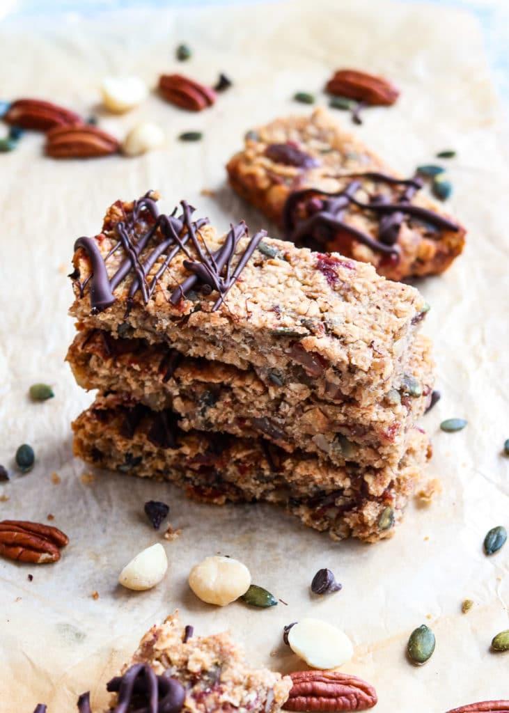 Closeup image of nutty vegan flapjacks with dark chocolate.