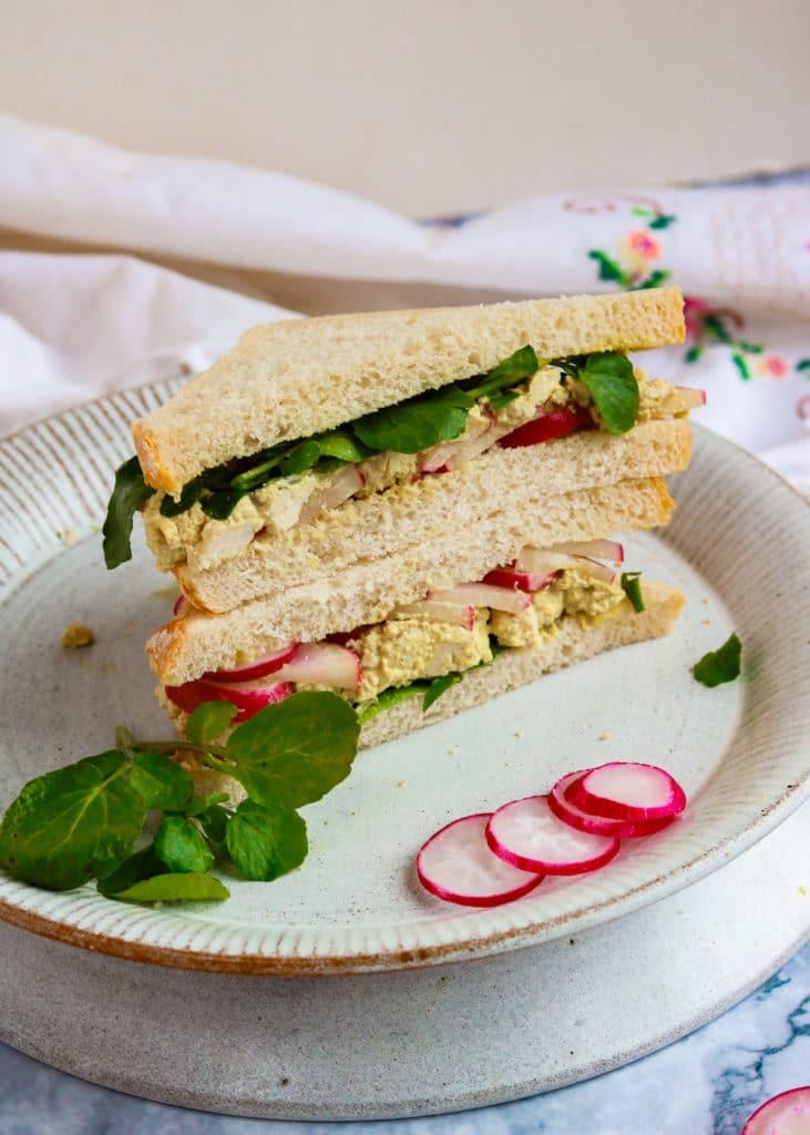 Classic Vegan 'Egg' and Cress sandwich cut open.