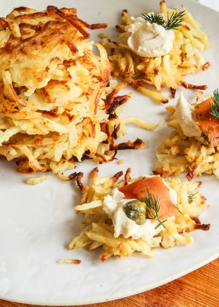 Parsnip and potato latkes with vegan cream cheese and carrot lox on top