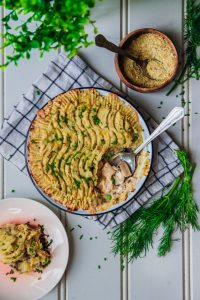 vegan fish pie in a dish with parsley
