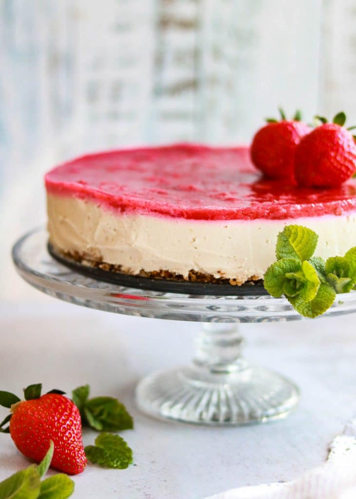 Vegan lemon and strawberry cheesecake on a plate