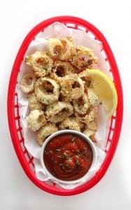 vegan calamari in a basket with dipping sauce