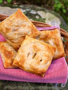 Little savoury hand pies in a basket.