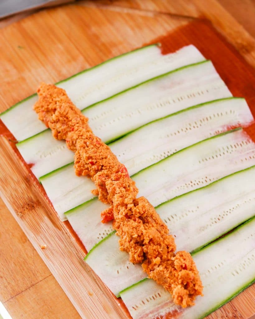 Macadamia Muhammara on a veggie sheet ready to roll.
