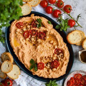Sun Dried Tomato Hummus on a plate.