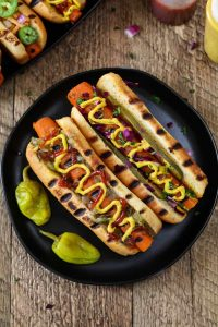 carrot hot dogs on a plate with mustard