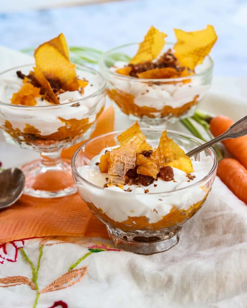 vegan carrot cake parfaits in glasses with spoons