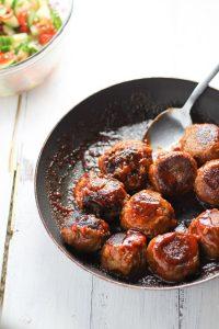 vegan lentil meatballs in a pan to show the perfect vegan BBQ recipe